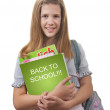 Stock Photo: Smiling girl with schoolbag