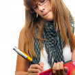 Young girl with glasses writes on the paper using giant pencil. - Stock Photo