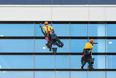 Two workers washing windows — Stock Photo