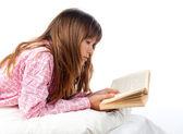 Teenage girl reads old book — Stock Photo