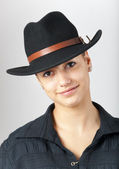 Portrait of the beautiful teenage girl wearing black cowboy hat. — Stock Photo