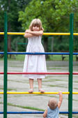 Brother and sister playing on the playground. — Stock Photo