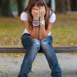 Young girl in sitting in the park — Stock Photo #7153103