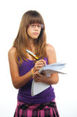 Young girl with glasses writes on the paper using giant pencil. — Stock Photo