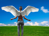 Girl with angel wings — Stock Photo