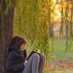 Pretty teenage girl reads the book — Stock Photo #7729931
