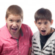 Two teenage boys shouting and screaming in surprise — Stock Photo