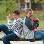 Two teenage boys having fun in the park — Stock Photo