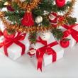 Decorated christmas tree and gifts under it — Stock Photo