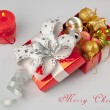 Beautiful Christmas decorations in red gift box and red candle - 