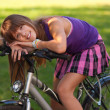 Beautiful teenage girl resting on the bicycle — Stock Photo #7804452