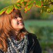 Beautiful teenage girl enjoying sunny autumn day in the park — Stock Photo
