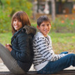 Teenage boy and girl spending time together in the park — Stock Photo