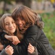 Teenage girls hugging each other in the park on the beautiful autumn day — Stock Photo #7846252