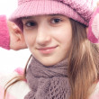 Beautiful teenage girl wearing fashionable cap, sweater and scarf. — Stok fotoğraf