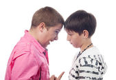 Two teenage boys arguing and screaming at each other — Stock Photo