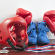 Gloves, helmet and shoes for fighting sports, and the medal - Stock Photo