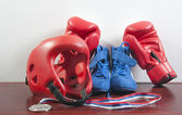 Gloves, helmet and shoes for fighting sports, and the medal — Stock Photo