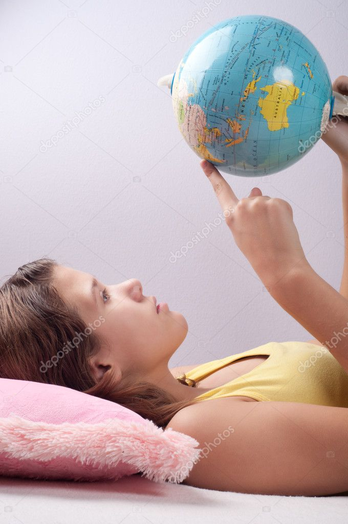 Pretty teenage girl studies earths geography  Stock Photo #7906945