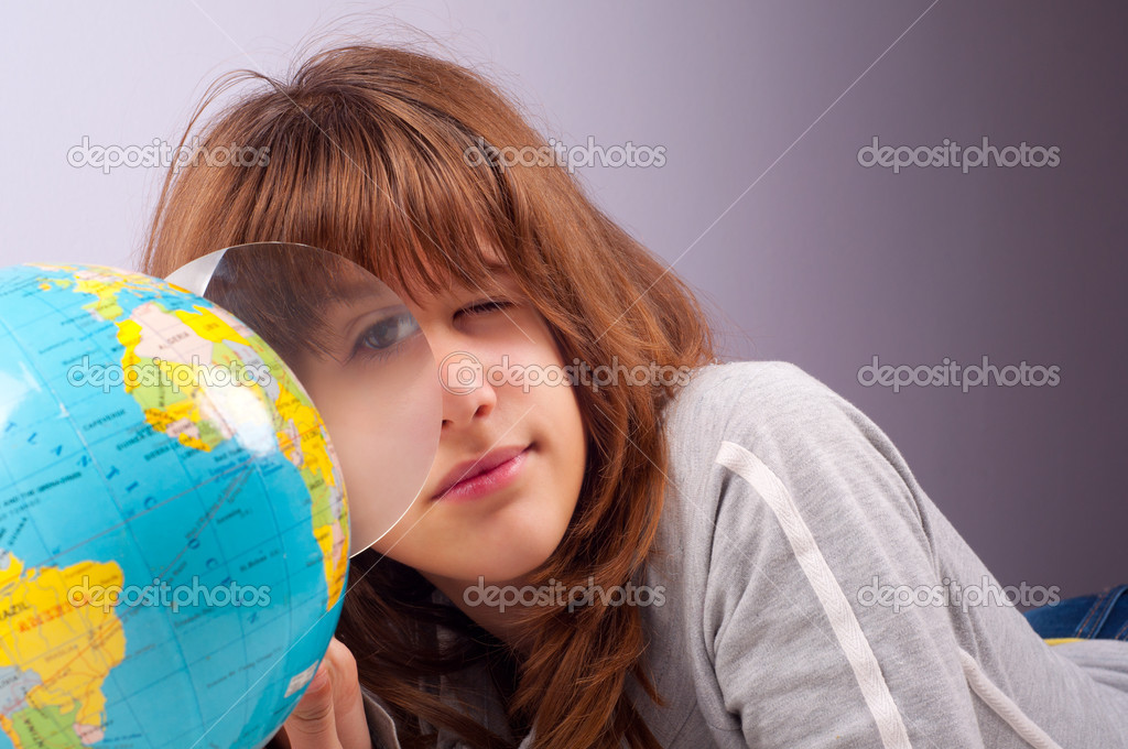 Pretty teenage girl studies earths geography — Stock Photo #7906991