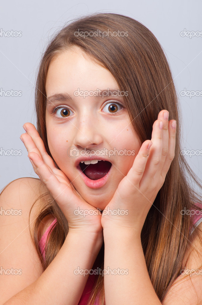 Beautiful Teenage Girl With Surprised Look On Her Face