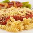 Rotini Pasta with Tomato Sauce, Cheese, and Sausage with Peppers and Onions — Stock Photo