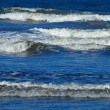 An Ocean Wave Breaking on Shore on a Sunny Day — Photo