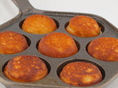 A Pan of Freshly Cooked Aebelskivers Awaiting Garnish — Stock Photo