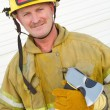 Firefighter Holding Axe - Stock Photo