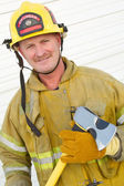 Firefighter Holding Axe — Stock Photo