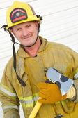 Firefighter Holding Axe — Stockfoto