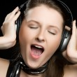 Stock Photo: Singing Headphones Woman