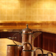 Old copper in kitchen focus on jug — Stock Photo