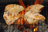 Four barbecue chicken breasts — Stock Photo