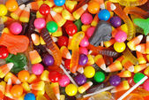 Mixed halloween candy background — Stock Photo