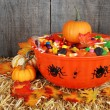 Bowl of halloween candy with fall leaves — Stock Photo #7091464