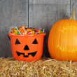 Happy halloween pumpkin and candy — Stock Photo