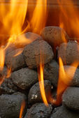 Charcoal barbecue briquettes — Stock Photo