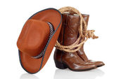 Cowboy boots hat and lasso — Stock Photo