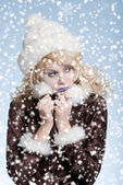 Cold woman in the snow — Stock Photo