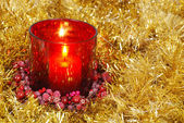 Red candle in gold garland — Stock Photo