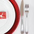 Christmas place setting with present - Stock Photo