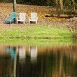Royalty-Free Stock Photo: Four chairs by the lake