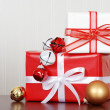 Pile of christmas gifts with bells — Stock Photo
