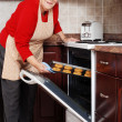 Senior woman baking cookies — Stock Photo