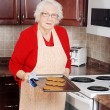 Senior woman christmas baking — Stock Photo