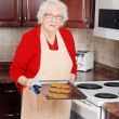 Senior woman christmas baking — Stock Photo #7574247