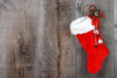 Christmas sock and wreath on wood — Stock Photo
