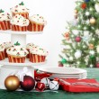 Holiday cupcakes with decorations — Stock Photo