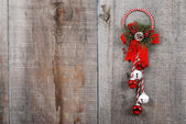 Christmas decoration hanging on wood — Stock Photo